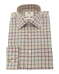 A subtle checked soft cotton shirt complements the texture of the cords.