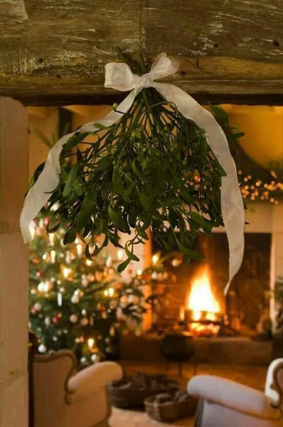 Kiss beneath the mistletoe. Image source: Pinterest.