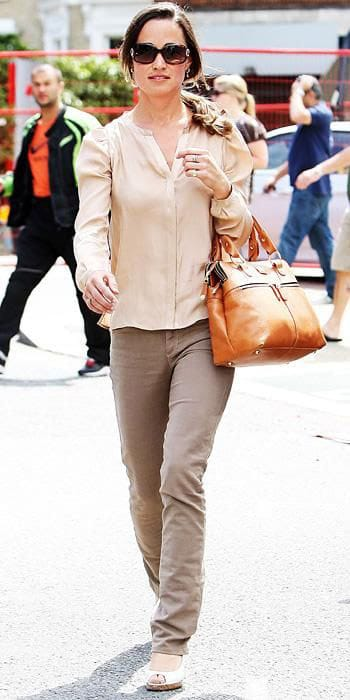 Pippa Middleton swinging the eponymous Modalu 'Pippa' bag.