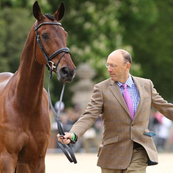 Bill Levett & Caroline Powell Trot Up at Badminton dressed by A Hume