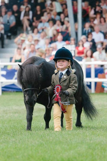 Girl with pony, wear tweed jacket at the Royal Highland Show